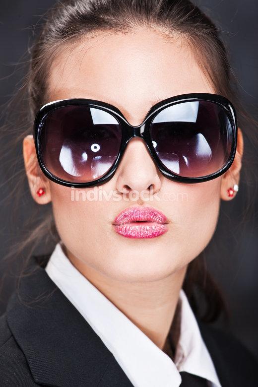 girl with sun glasses sending kiss