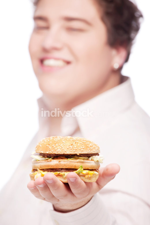 hamburger in hand of a chubby man