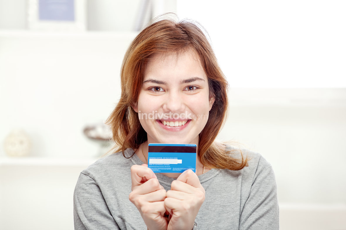 Happy girl holding credit card