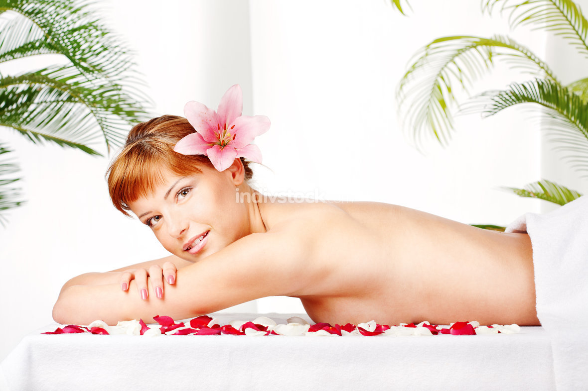 Lady on massage table in spa salon