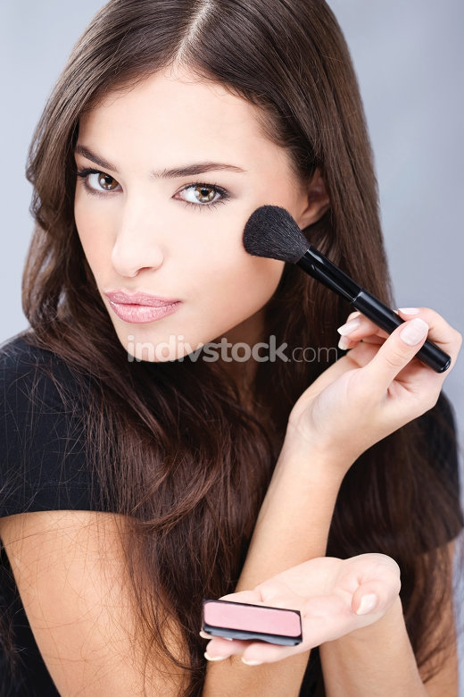 make up with powder brush