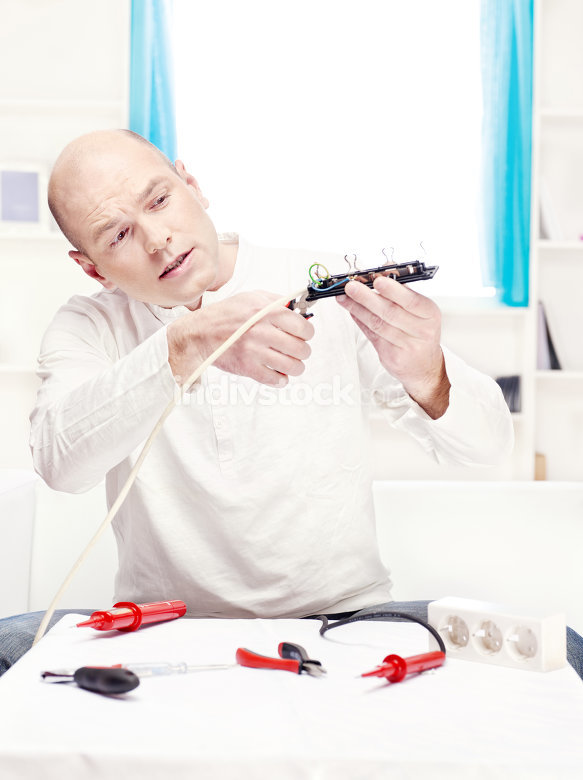 man doing minor repair at home