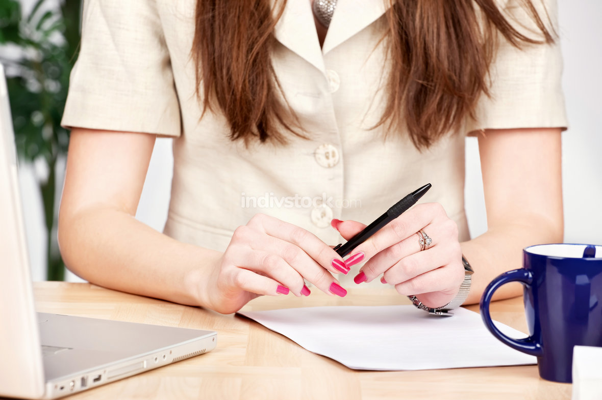 pen in a hands of a business woman