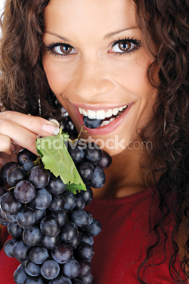 pretty girl eating grape