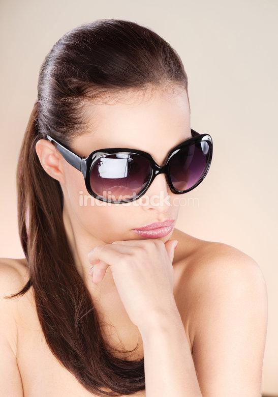 Pretty woman with big sun glasses