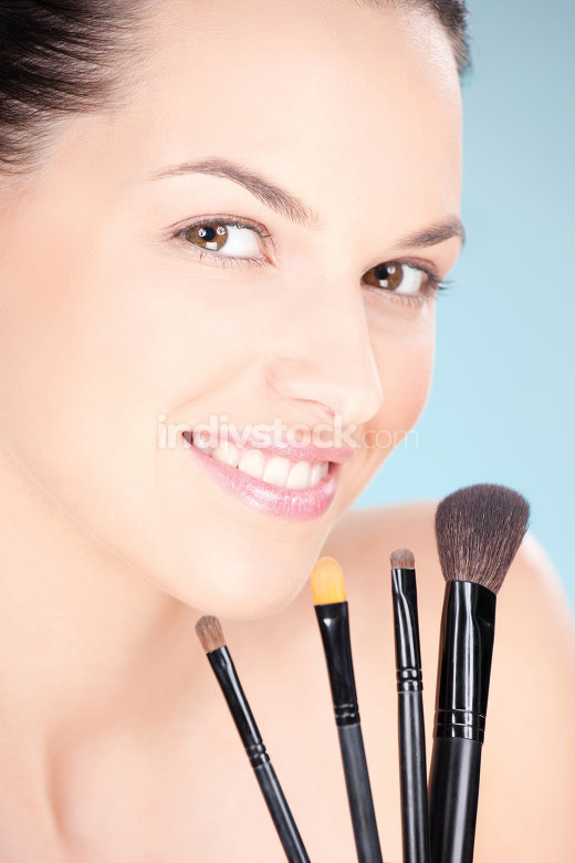 woman and make up brushes