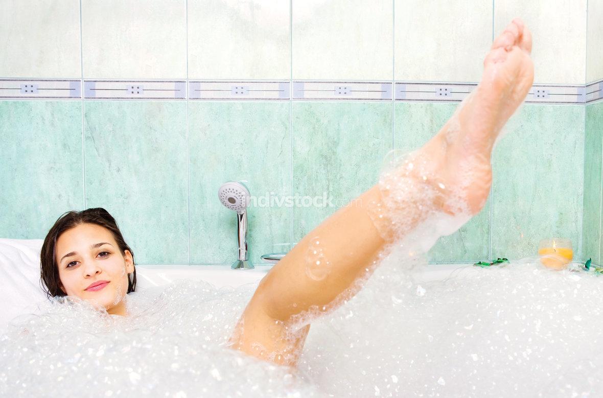 woman enjoy bath foam in bathtub