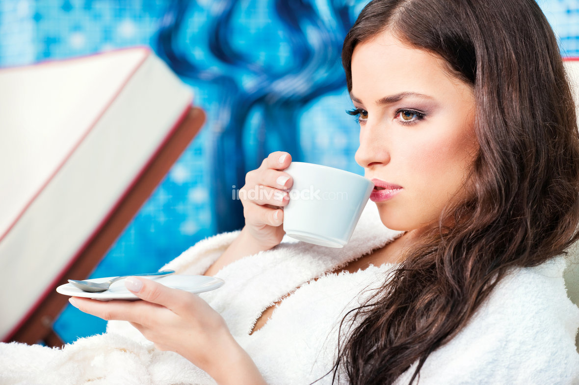 Woman enjoy coffee in spa center