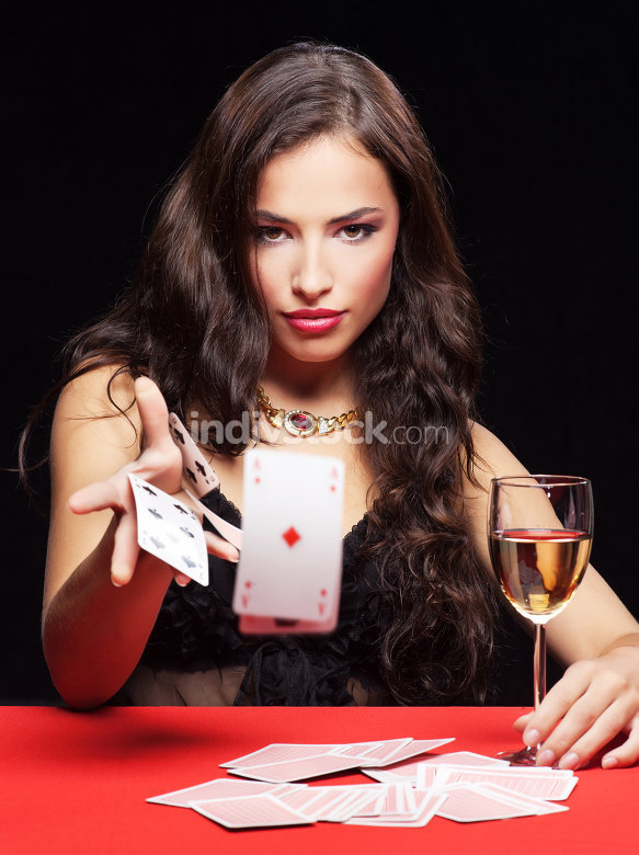 woman gambling on red table