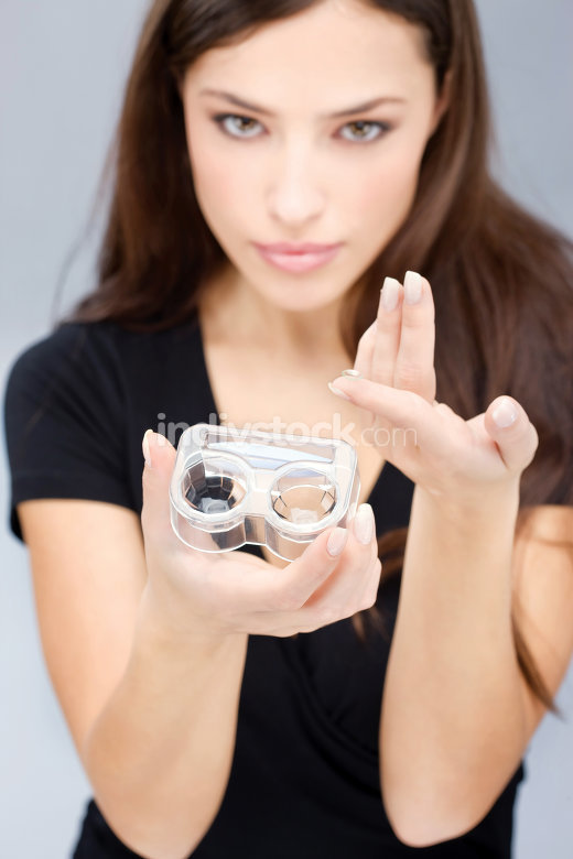 woman hold contact lenses cases