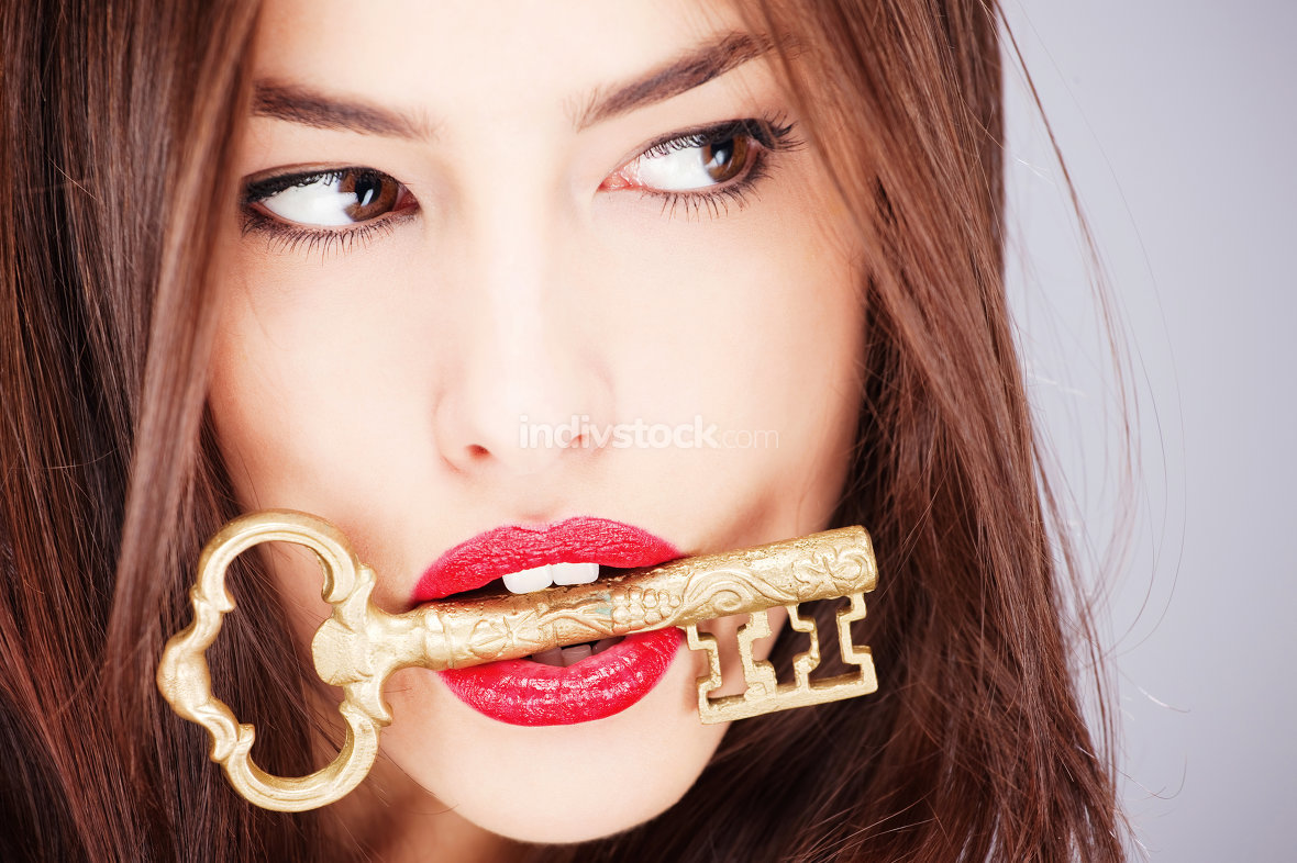 woman holding big old key