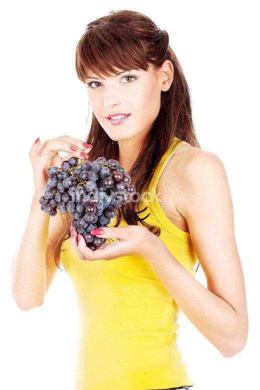 Woman holding grape