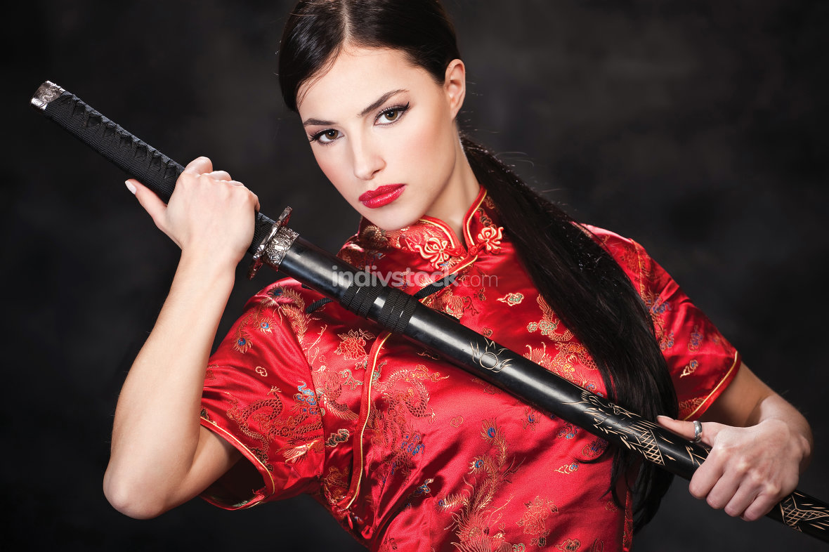woman holding katana weapon