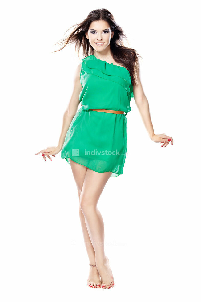woman in green dress barefoot