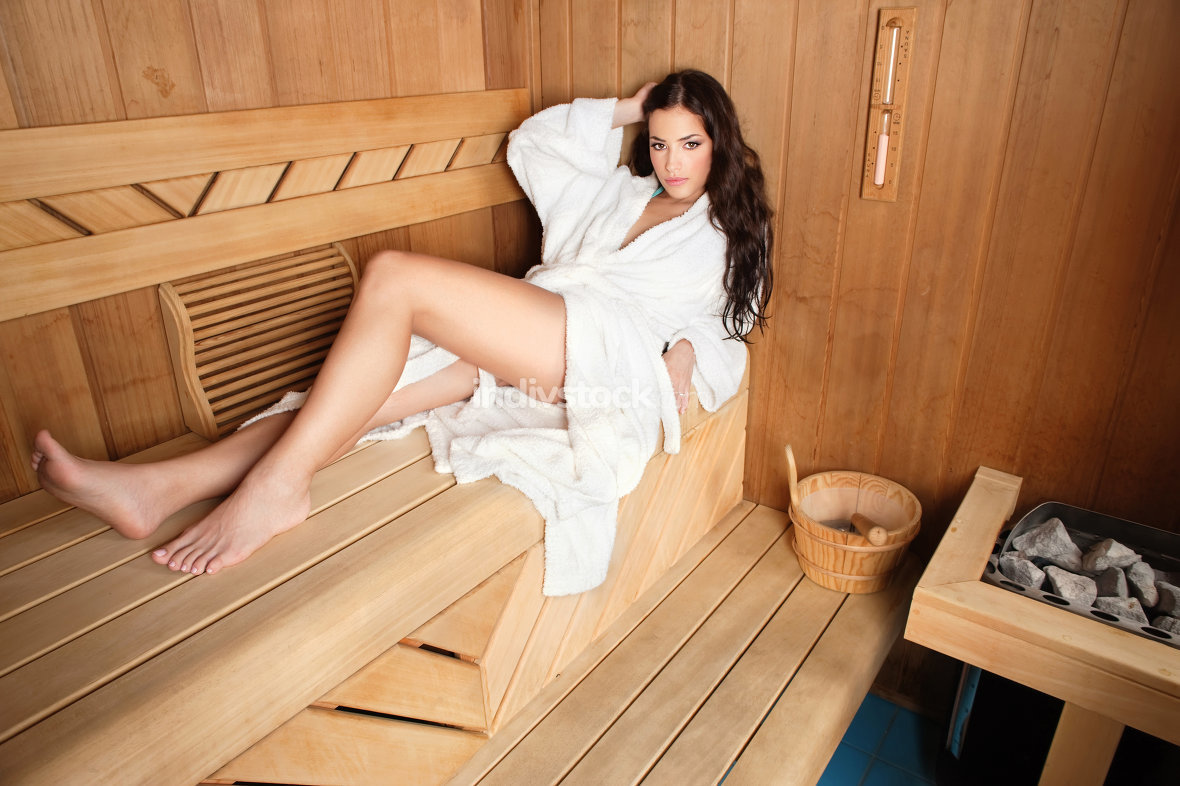 woman in wooden sauna