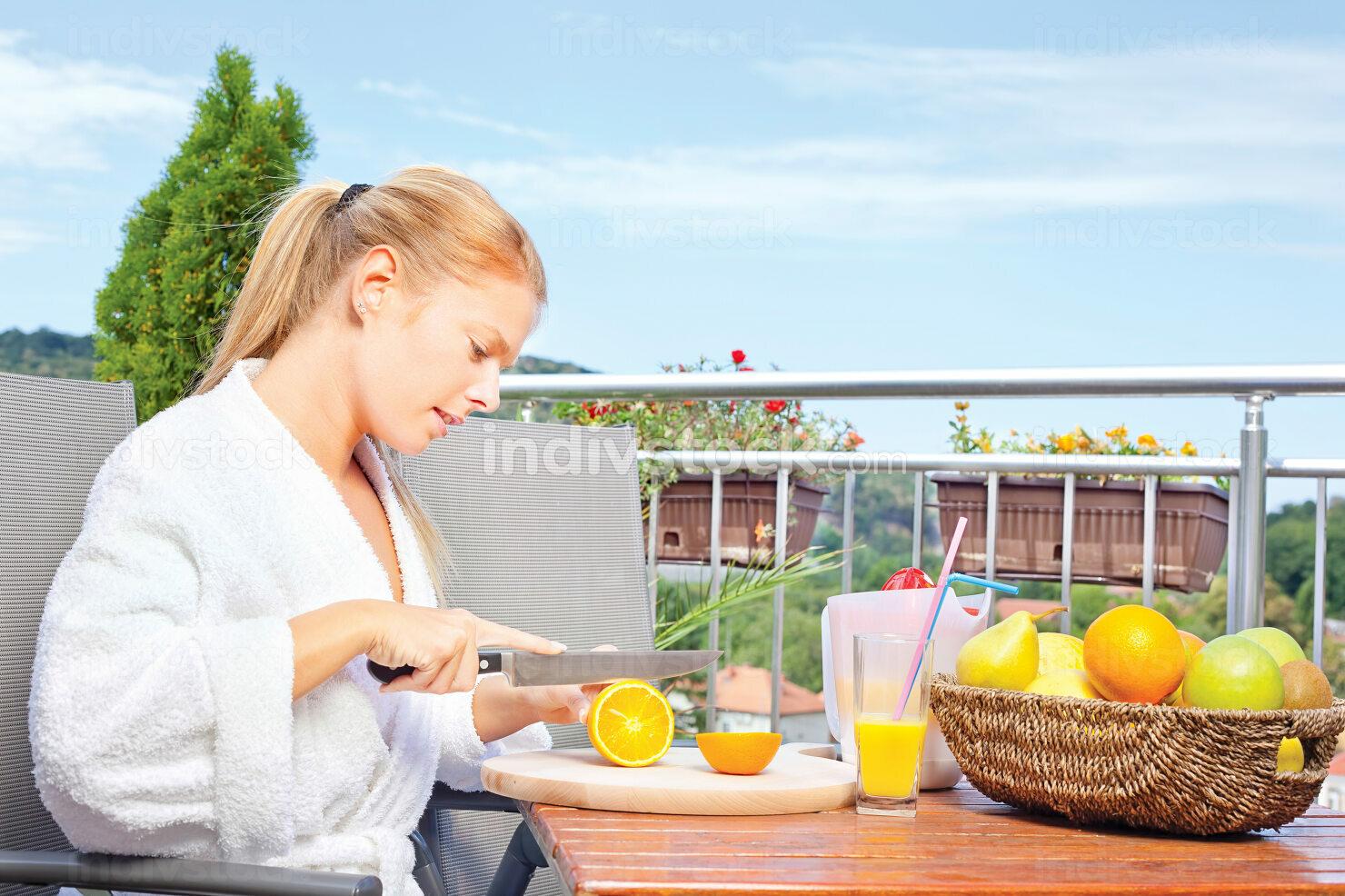 Woman making morning juice