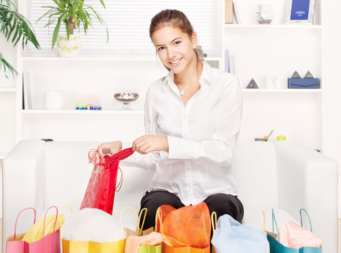 woman on couch with shopping bags