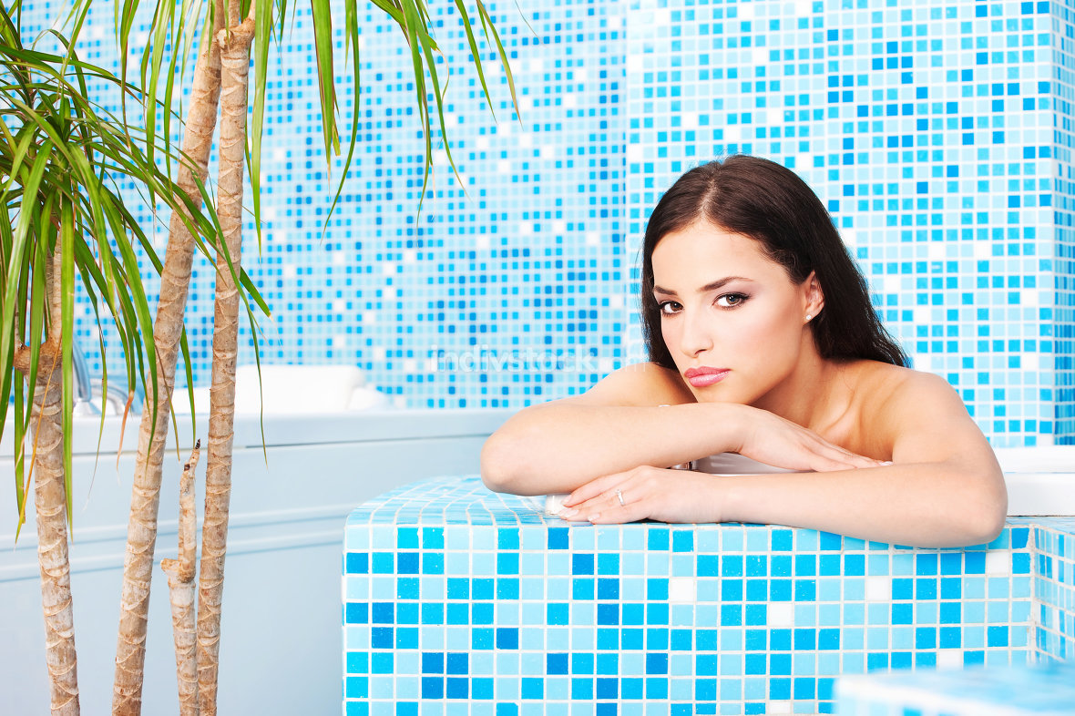 Woman relaxing in spa center