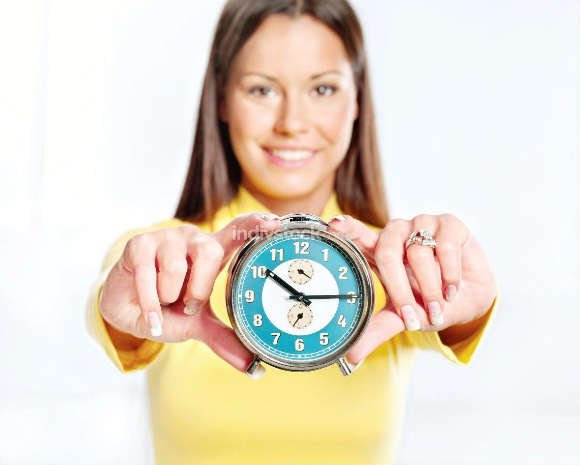 Woman showing alarm clock