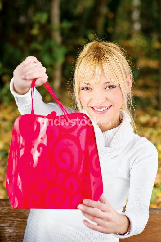 woman showing her shopping bag