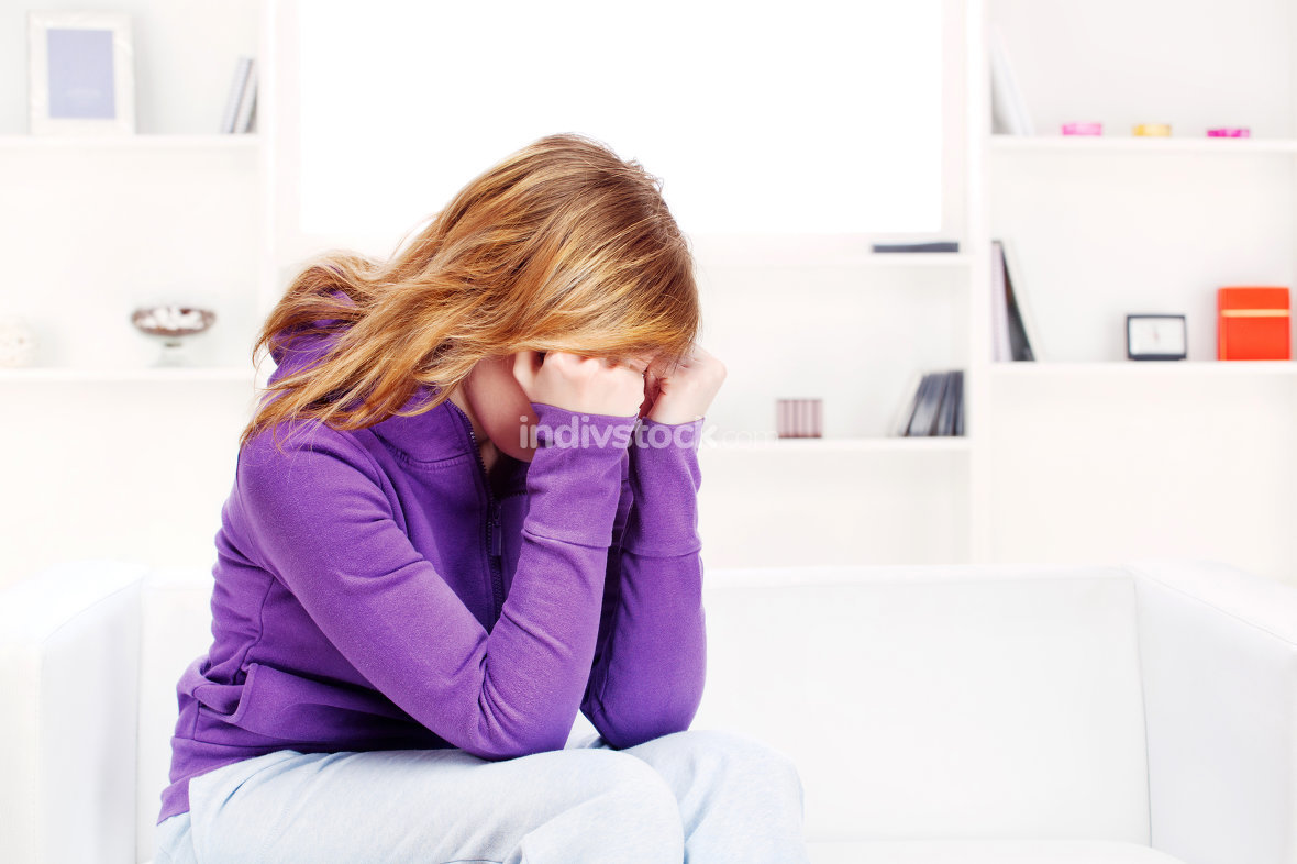 worried teenage girl at home