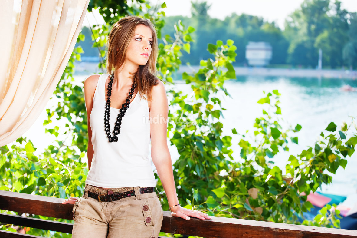 Young woman near river