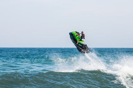 Man on jet ski with high speed and adrenalin.