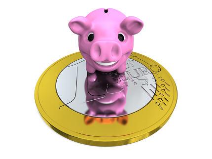 Piggy bank on Euro coin