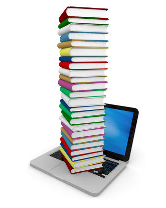 Pile of books on laptop