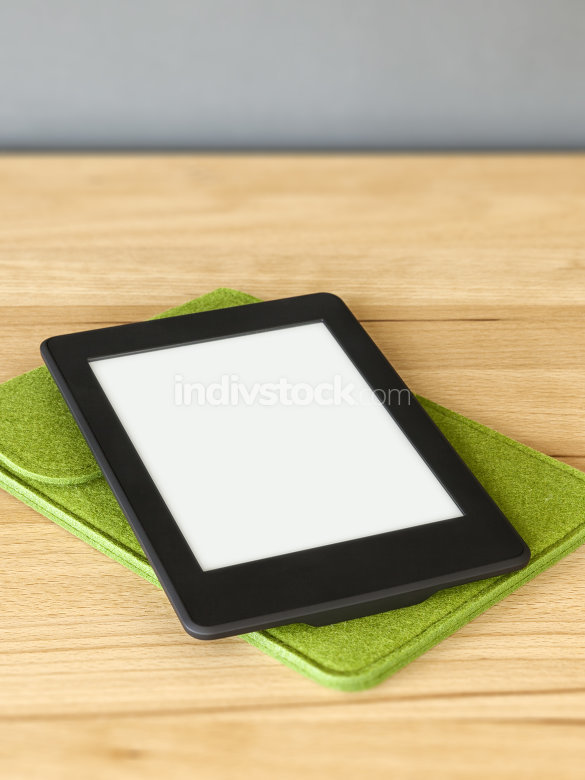 ebook reader on a wooden table