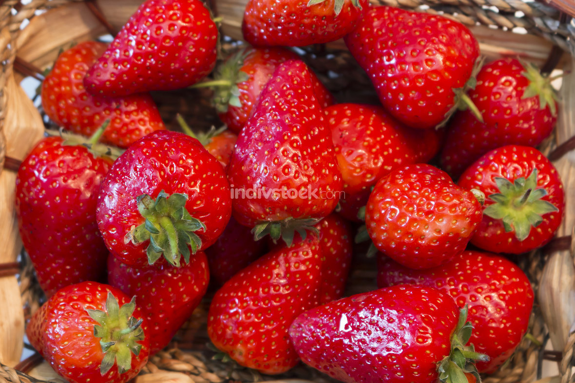 fresh sweet strawberries in basket, close up