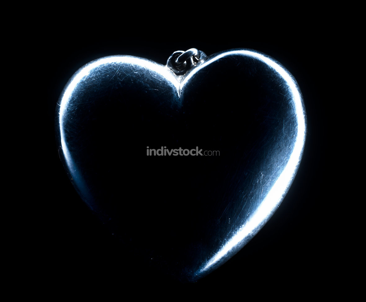Heart shape emerging from a black background.