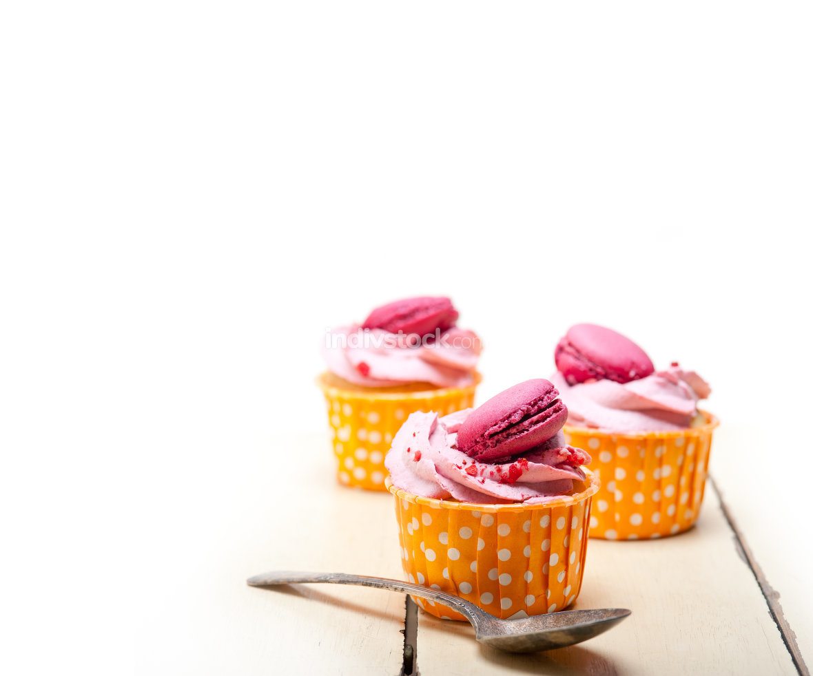 pink berry cream cupcake with macaroon on top