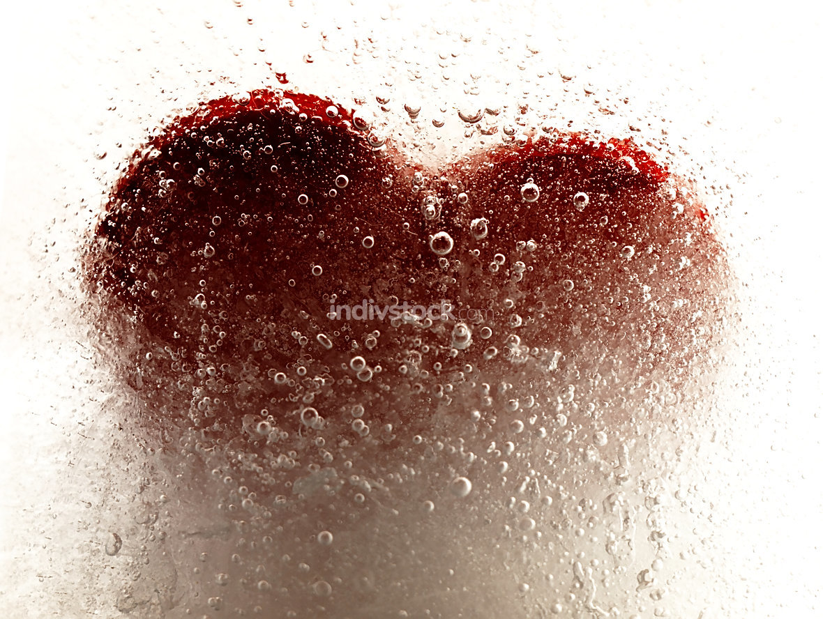 Red heart embedded in ice.