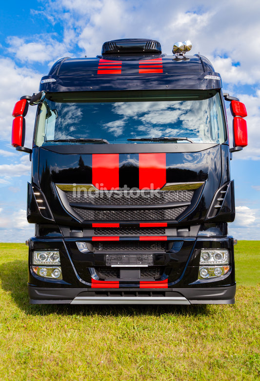 red striped big rig on grass