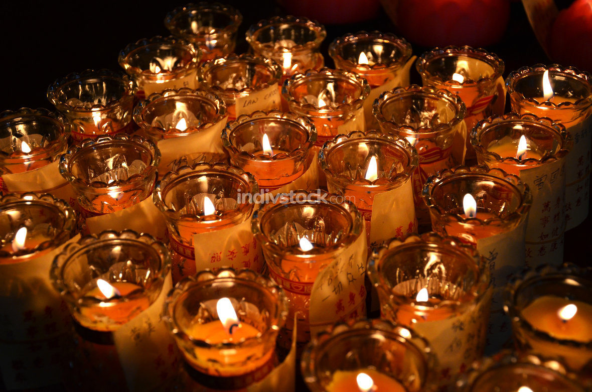 Temple candles in transparent chandeliers