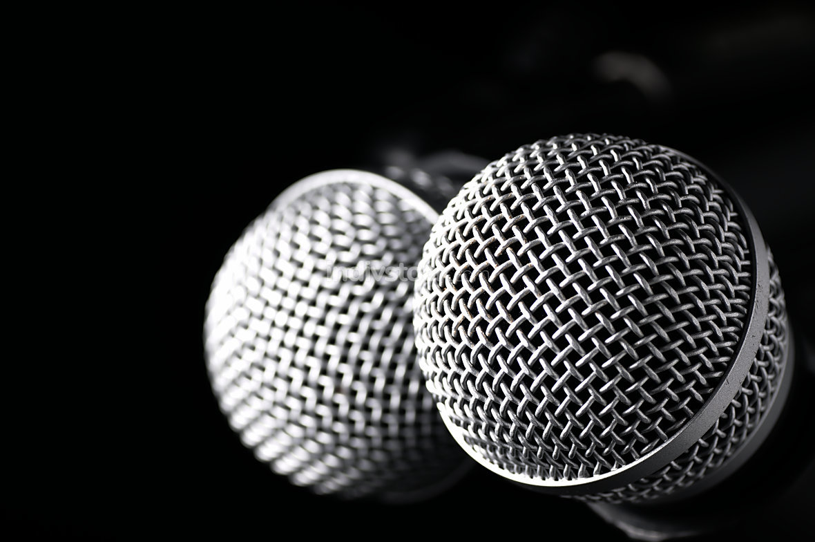 Two microphones on a black background.