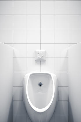 a white urinal with space