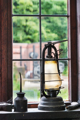 Antique kerosene lamp and oil can