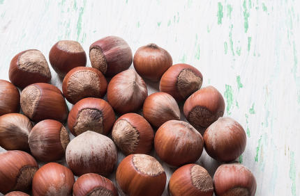 nuts in shell on wooden background
