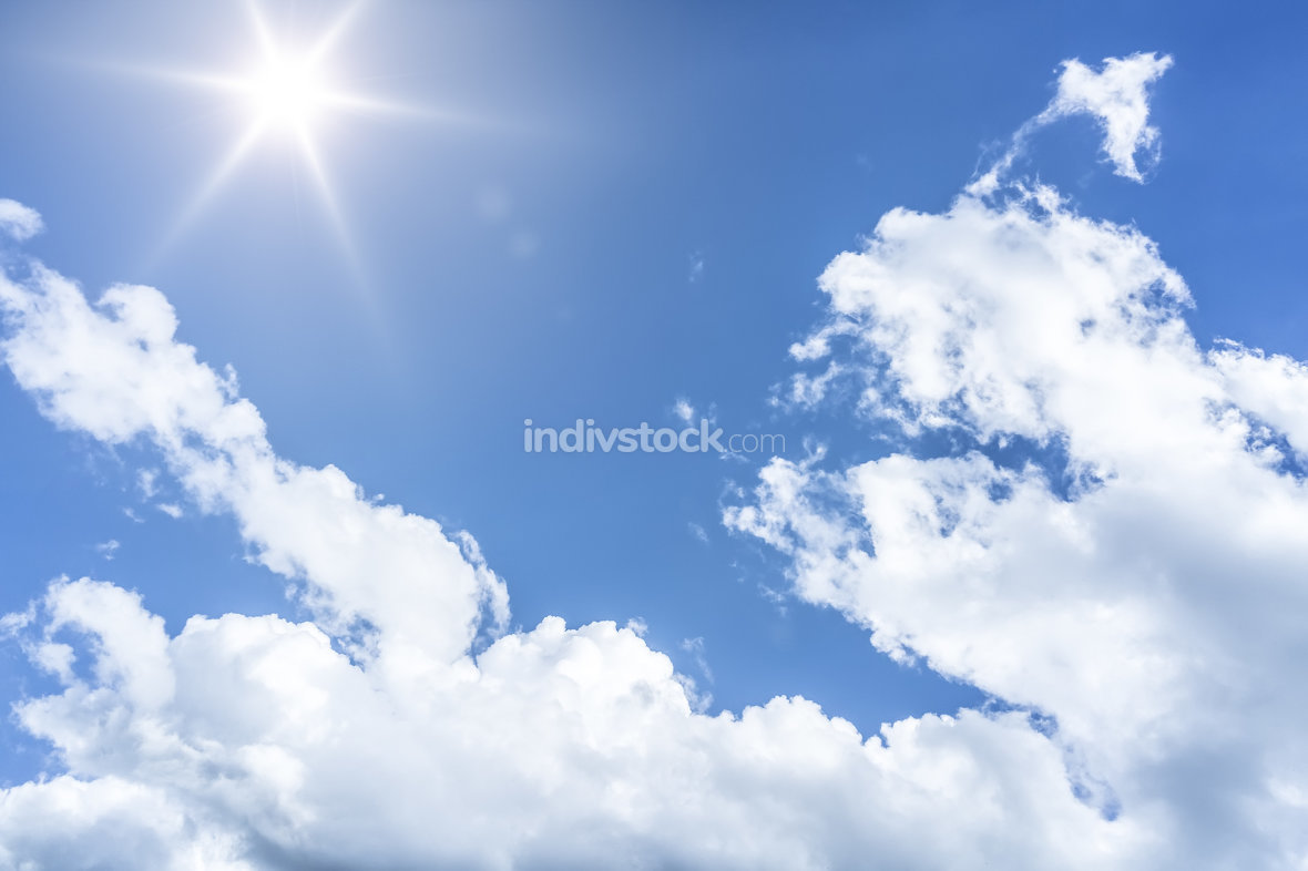 An image of a blue sky sun background
