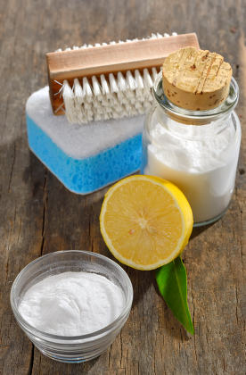 Baking soda, lemon, sponge for cleaning