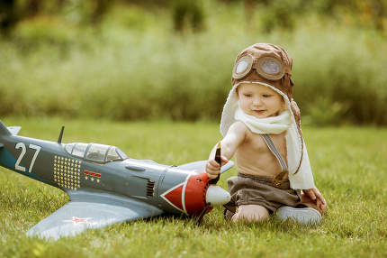 Child pilot. Kid playing outdoors