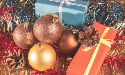 Christmas gifts among the balls and tinsel