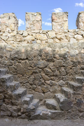 Firewall, Stone walls of a medieval castle. Town of Consuegra in