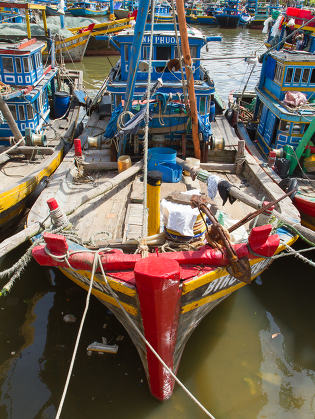fishing boats in a harbour in Vietnam