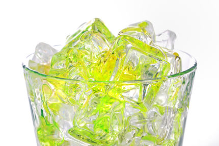 juice in glass with ice cubes