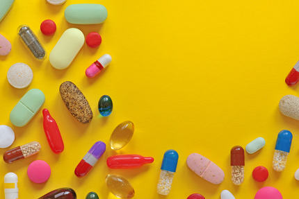 Many colorful pills isolated
