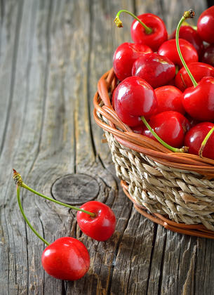 red sweet cherries in a  basket