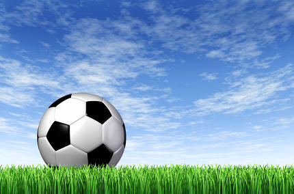 Soccer Ball and grass Field background